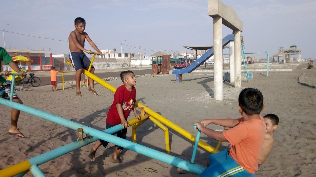 Playing on the beach nearby